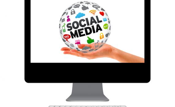 social-media-hand-computer